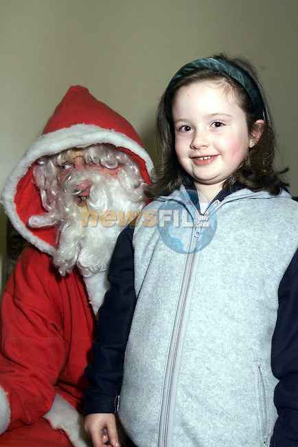 Caoimhe O'Neill, Castle Street with Santa in the Ardee Day Care Centre..Picture: Paul Mohan/Newsfile
