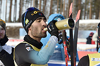 March 14th 2020, Kontiolahti, Finland;   Martin Fourcade of France takes a drink as he celebrates victory and end of career after the mens 12.5 km Pursuit competition at the IBU Biathlon World Cup in Kontiolahti, Finland, on March 14, 2020. Fourcade ends his career now at the end of the season in Kontiolahti where he took his first World Cup victory exactly 10 years ago on March 14, 2010.