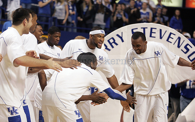 Senior forward Perry Stevenson high fives his teammates during senior day festivities before UK's win over Florida at Rupp Arena on Sunday, March 7, 2010. Photo by Britney McIntosh | Staff