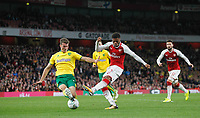 Chuba Akpom of Arsenal hits a shot under pressure from Christoph Zimmermann of Norwich City during the Carabao Cup match between Arsenal and Norwich City at the Emirates Stadium, London, England on 24 October 2017. Photo by Carlton Myrie.