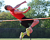 Joe Neunzig of Connetquot competes in the high jump event during a Suffolk County boys' track and field meet against Middle Country at Connetquot High School on Thursday, May 14, 2015. He cleared the bar at five feet, four inches to win the event.<br /> <br /> James Escher