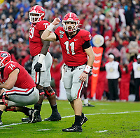 ATHENS, GA - NOVEMBER 23: Jake Fromm #11 of the Georgia Bulldogs audibles at the line during a game between Texas A