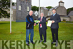 Minister Kevin Boxer Moran centre presenting a green flag to James O'Shea(Foreman at Derrynane Historic Park) on Friday and right Chris O'Neill OPW Parks Superintendent.  Derrynane is the only Park in Kerry to receive this Award.