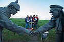 25/12/14<br /> <br /> Football fans from around the world pay their respects by a sculpture depicting two WW1 soldiers playing football during the famous Christmas Day truce in the field near Messine, Belgium, close to where the match was played in Flanders, Belgium.<br /> <br /> The sculpture, made in England, arrived in Flanders on Christmas Eve, and was first displayed in the town centre before being taken to the spot where the match was played. <br /> <br /> Sculpted by Andy Edwards the work is entitled &lsquo;All Together Now&rsquo;, recalling the song by the band The Farm - which was inspired by the truce. <br /> <br /> Chris Butler said: &ldquo;Castle Fine Arts are proud to have cast a number of war memorials over the years. We are honoured to support this sculpture for peace. I believe it will touch the hearts of millions.&rdquo;<br /> <br /> <br /> &ldquo;It will be a symbol of peace and hope and a call for a renewed worldwide cessation of violence in honour of those brave boys who &lsquo;joined together and decided not to fight&rsquo;&rdquo;.<br /> <br /> <br /> The statue depicts the meeting of a British and a German soldier over a football, deep in the mud between the lines on that first Christmas of the war. The soldiers appear to be shaking hands but  are not not quite touching, forming a space in which a visitor can insert their own hand to complete the union.  A chance for a moments reflection on how far we are from true peace and brotherhood and the part each of us has to play in that dream. We want the work to stand as both a celebration of this inspirational and heroic event and as symbol of hope and peace. <br /> <br /> The project was instigated some years ago, with the support of the Football Asscociation (FA), as football&rsquo;s contribution to the First World War commemorations. <br /> <br /> All Rights Reserved - F Stop Press. www.fstoppress.com. Tel: +44 (0)1335 300098