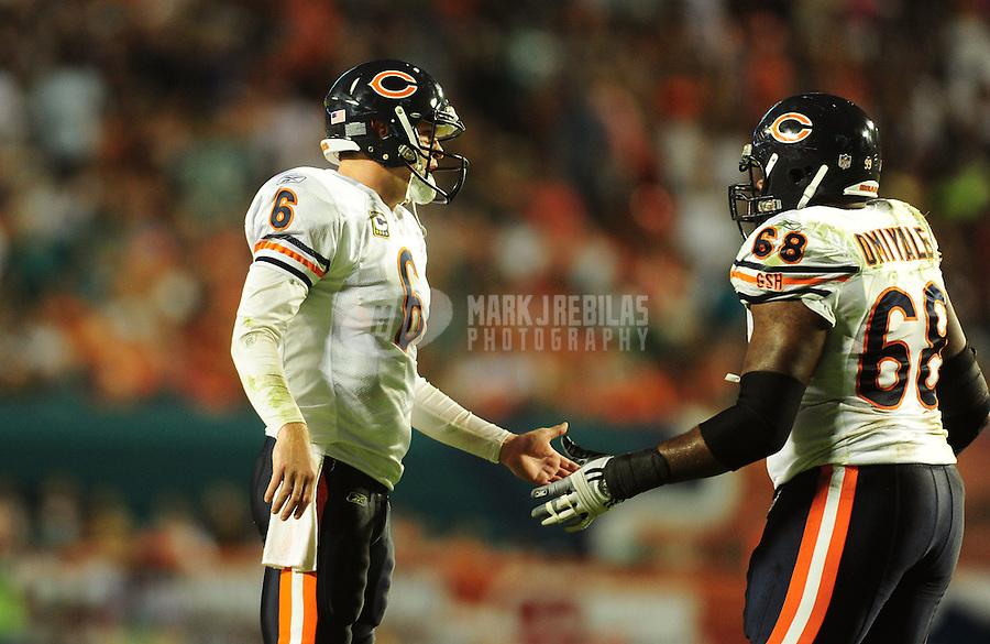 Nov. 18, 2010;  Miami, FL, USA; Chicago Bears quarterback (6) Jay Cutler celebrates a play with guard (68) Frank Omiyale against the Miami Dolphins at Sun Life Stadium. Mandatory Credit: Mark J. Rebilas-