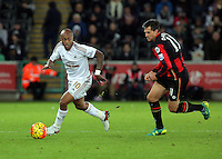 (L-R) Andre Ayew of Swansea chased by Charlie Daniels of Bournemouth during the Barclays Premier League match between Swansea City and Bournemouth at the Liberty Stadium, Swansea on November 21 2015