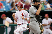 Oklahoma's Chris Ellison scores in Game 3 of the NCAA Division One Men's College World Series on Sunday June 20th, 2010 at Johnny Rosenblatt Stadium in Omaha, Nebraska.  (Photo by Andrew Woolley / Four Seam Images)