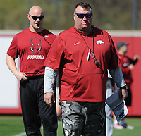 NWA Democrat-Gazette/ANDY SHUPE<br /> Arkansas coach Bret Bielema (right) watches Saturday, April 1, 2017, as head strength and conditioning coach Ben Herbert  leads warmup drills during practice at the university practice field in Fayetteville. Visit nwadg.com/photos to see more photographs from practice.