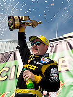 Jun. 1, 2014; Englishtown, NJ, USA; NHRA top fuel driver Richie Crampton celebrates after winning the Summernationals at Raceway Park. Mandatory Credit: Mark J. Rebilas-