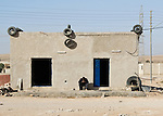 """Blue Door"" -- A small shop by the side of the ""desert highway,"" south of Amman Jordan.  © Rick Collier"