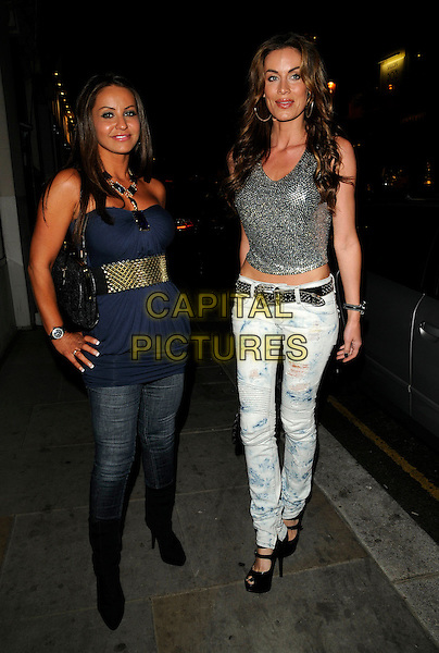 GUEST & JO-EMMA LAVIN.The Eclipse Barcelona launch party, Eclipse, Walton St., London, England..September 9th, 2009.full length larvin lanvin ripped torn jeans denim faded silver sequins sequined top black platform shoes peep toe boots tucked into blue strapless top gold belt hands on hips .CAP/CAN.©Can Nguyen/Capital Pictures.