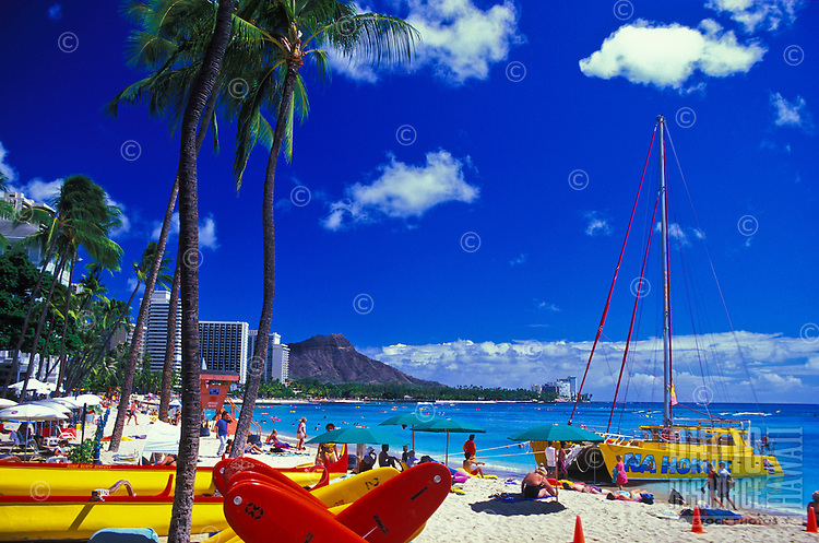 Diamond Head Crater and inviting sands of legendary Waikiki Beach.