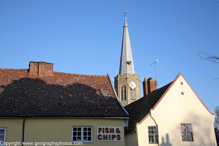 Church spire viewed over fish and chips shop, Wickham Market, Suffolk, England