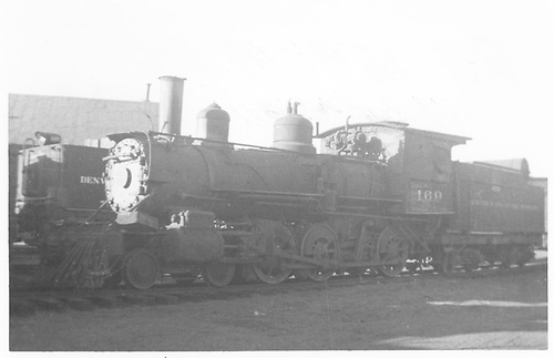3/4 fireman's-side view of D&amp;RGW #169 stored at Alamosa.<br /> D&amp;RGW  Alamosa, CO  Taken by Maxwell, John W. - 1938