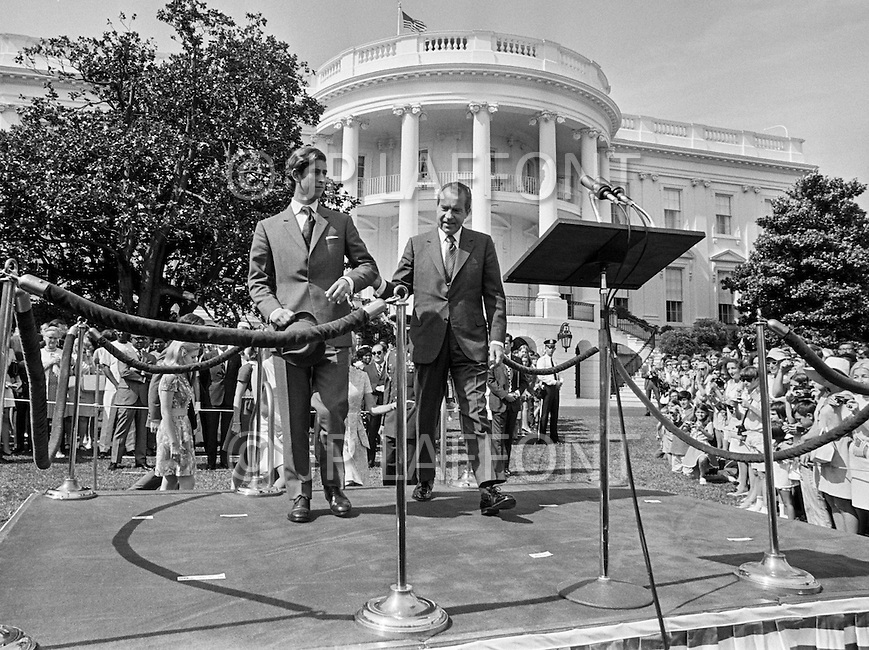16 Jul 1970, Washington, DC, USA --- Charles, Prince of Wales, and President Richard Nixon step up to the lectern on the South Lawn of the White House. Prince Charles and his sister Princess Anne visited the US after an official stay in Canada. --- Image by © JP Laffont