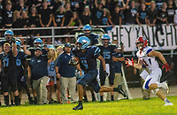 North Penn's Kenneth Grandy #4 is chased by Neshaminy's Greg Orleski #21 as he scores a touchdown on the longest play in school history of 100 yards in the second quarter of the Neshaminy at North Penn footballgame Friday, August 23, 2019 at North Penn High School in Towamencin, Pennsylvania. (WILLIAM THOMAS CAIN / PHOTOJOURNALIST)