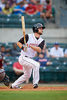 Arkansas Travelers right fielder Kyle Waldrop (10) follows through on a swing during a game against the Frisco RoughRiders on May 26, 2017 at Dickey-Stephens Park in Little Rock, Arkansas.  Arkansas defeated Frisco 4-2.  (Mike Janes/Four Seam Images)