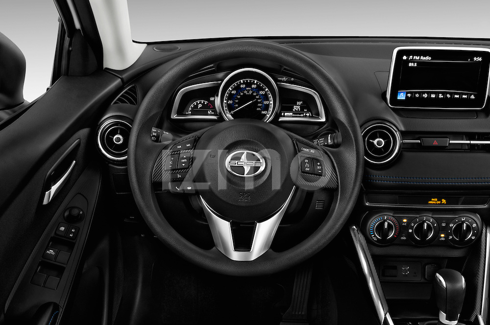 Car pictures of steering wheel view of a 2016 Scion iA 4 Door Sedan Steering Wheel