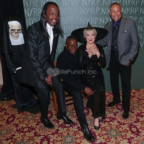 """NEW YORK, NY - OCTOBER 31 : Singer and Actress Bette Midler and members of Earth, Wind and Fire arrive for the New York Restoration Project's 19th Annual Hulaween Gala """"FELLINI HULAWEENI"""" held at the Waldorf Astoria on October 31, 2014 in New York City.  (Photo by Brent N. Clarke / MediaPunch)"""