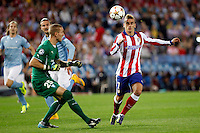 Griezmann of Atletico de Madrid and Robin Olsen of Malmoe during Champios Legue soccer match between Atletico de Madrid V Malmoe al Vicente Calderon Stadium. October 22, 2014. (ALTERPHOTOS/Caro Marin)