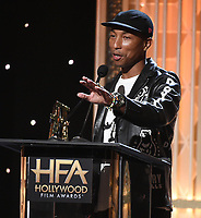 """BEVERLY HILLS - NOVEMBER 3: Pharrell Williams accepts the Hollywood Song Award for """"Letter to My Godfather"""" onstage at the 2019 Hollywood Film Awards at the Beverly Hilton on November 3, 2019 in Beverly Hills, California. (Photo by Frank Micelotta/PictureGroup)"""