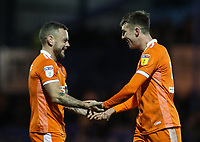 Blackpool's Jay Spearing congratulates winning goal scorer Chris Long after the match<br /> <br /> Photographer Andrew Kearns/CameraSport<br /> <br /> The EFL Sky Bet League One - Portsmouth v Blackpool - Saturday 12th January 2019 - Fratton Park - Portsmouth<br /> <br /> World Copyright © 2019 CameraSport. All rights reserved. 43 Linden Ave. Countesthorpe. Leicester. England. LE8 5PG - Tel: +44 (0) 116 277 4147 - admin@camerasport.com - www.camerasport.com