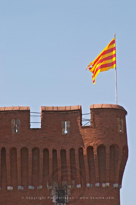 Le Castillet. Catalan flag. Perpignan, Roussillon, France.