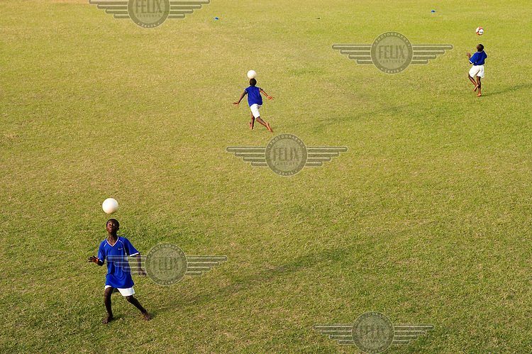 Boys practice their skills on a pitch at the JMG football academy in Bamako.