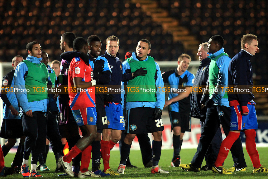 Wycombe's Dean Morgan exchanges words with some of the Dagenham players at the end of the match - Wycombe Wanderers vs Dagenham & Redbridge - NPower League Two Football at Adams Park, High Wycombe - 19/01/13 - MANDATORY CREDIT: Paul Dennis/TGSPHOTO - Self billing applies where appropriate - 0845 094 6026 - contact@tgsphoto.co.uk - NO UNPAID USE.