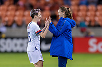 HOUSTON, TX - JANUARY 28: Megan Rapinoe #14 and Andi Sullivan #6 of the United States celebrate the win during a game between Haiti and USWNT at BBVA Stadium on January 28, 2020 in Houston, Texas.