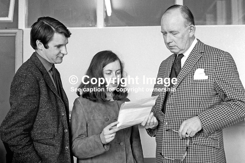 Bernadette Devlin, standing as a Unity candidate, hands in her nomination papers for the 17th April 1969 Mid-Ulster by-election, to the returning officer, Stanley Rountree. Also in the photo is Loudon Seth, a fellow QUB student, who managed her election campaign. 196904050146BD1.<br />