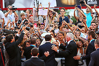 Johnny Depp signs autographs on the red carpet for the movie 'Black Mass' during 72nd Venice Film Festival at the Palazzo Del Cinema in Venice, Italy, September 4, 2015. <br /> UPDATE IMAGES PRESS/Stephen Richie