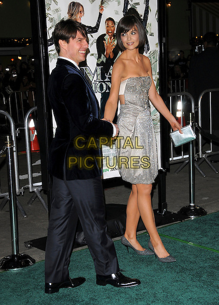 "TOM CRUISE & KATIE HOLMES .Overature Pictures' L.A. Premiere of ""Mad Money"" held at The Mann Village Theatre in Westwood, California, USA..January 9th, 2008.full length blue suit jacket strapless silver dress jewel encrusted married husband wife clutch bag purse grey gray trousers holding hands beads beaded.CAP/DVS.©Debbie VanStory/Capital Pictures"