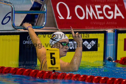 Jenny Mensing of Germany celebrates her victory in the Women's 100m Backstroke of the 31th European Swimming Championships in Debrecen, Hungary on May 23, 2012. ATTILA VOLGYI