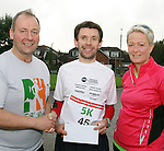 Brian Mc Cluskey, North East Runners, winner of the mens 5k Ferdia Challenge sponsored run event in aid of St John of God, Drumcar and the Special Care Baby Unit, Our Lady of Lourdes Hospital, Drogheda being presented with his prize by organisers organisers Frank Lynch (left) and Patricia Bannon