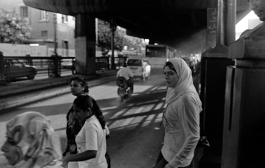 A young woman crosses the street under and overpass in downtown Cairo, Egypt, October 2009. Photo: Ed Giles.