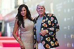 John Daly of USA and his friend walk the Red Carpet event at the World Celebrity Pro-Am 2016 Mission Hills China Golf Tournament on 20 October 2016, in Haikou, China. Photo by Weixiang Lim / Power Sport Images