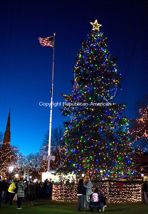 Waterbury, CT- 01 November 2015-112915CM08-  A Christmas tree is lit up on the Waterbury Green on Sunday night.  The city held it's annual Christmas tree lighting ceremony which featured music, food, parade and horse drawn carriage rides.   Christopher Massa Republican-American