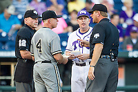 TCU Horned Frogs Head Coach Jim Schlossnagle (22) exchanges lineup cards with Vanderbilt Commodores Head Coach Tim Corbin (4) before the NCAA College baseball World Series on June 16, 2015 at TD Ameritrade Park in Omaha, Nebraska. Vanderbilt defeated TCU 1-0. (Andrew Woolley/Four Seam Images)