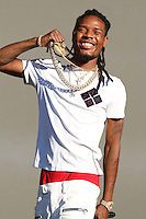 NEW YORK, NY - AUGUST 20: Fetty Wap performing live at the 2016 Billboard Hot 100 Music Festival at Nikon at Jones Beach Theater on August 20, 2016 in Wantagh, New York. Credit: Walik Goshorn/MediaPunch