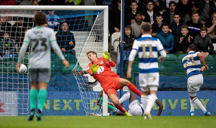 Blackburn Rovers' goalkeeper Christian Walton  is beaten by Queens Park Rangers' Nahki Wells (right) to score their first goal<br /> <br /> Photographer Andrew Kearns/CameraSport<br /> <br /> The EFL Sky Bet Championship - Queens Park Rangers v Blackburn Rovers - Saturday 5th October 2019 - Loftus Road - London<br /> <br /> World Copyright © 2019 CameraSport. All rights reserved. 43 Linden Ave. Countesthorpe. Leicester. England. LE8 5PG - Tel: +44 (0) 116 277 4147 - admin@camerasport.com - www.camerasport.com