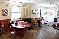 ethnic dining table<br /> <br /> One bedroom apartment on East 14th Street in the East Village in New York City with beautiful views on three sides.  The front part of the apartment is used as a studio and the rest is living quarters decorated in colorful Mexican shades.