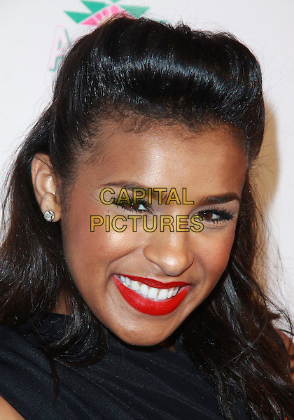 MELODY THORNTON (EX PUSSYCAT DOLLS).Attending Perez Hilton's Carn-Evil 32nd Birthday Party held at Paramount Studios, Los Angeles, California, USA, 27th March 2010..arrivals portrait headshot hair quiff red lipstick beauty make-up  black .CAP/ADM/TC.©T.Conrad/Admedia/Capital Pictures