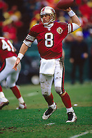 SAN FRANCISCO, CA - Quarterback Steve Young of the San Francisco 49ers in action during a playoff game against the Philadelphia Eagles at Candlestick Park in San Francisco, California in 1996. Photo by Brad Mangin