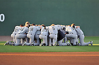 The South Carolina Gamecocks pause for a moment before a game against the USC Upstate Spartans on Tuesday, March 15, 2016, at Fluor Field at the West End in Greenville, South Carolina. (Tom Priddy/Four Seam Images)