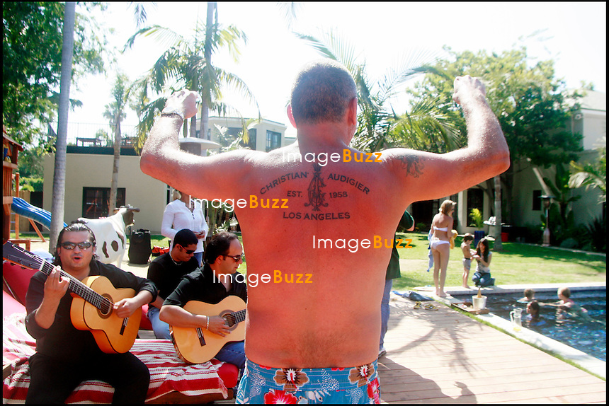 EXCLUSIF - CHRISTIAN AUDIGIER CELEBRE LA FETE DES PERES AU BORD DE SA PISCINE A LOS ANGELES AVEC MARIO REYES ET THE GYPSIES.<br /> <br /> EXCLUSIVE - CHRISTIAN AUDIGIER CELEBRATES FATHER'S DAY BY HIS SWIMMING POOL WITH MARIO REYES EAND THE GYPSIES