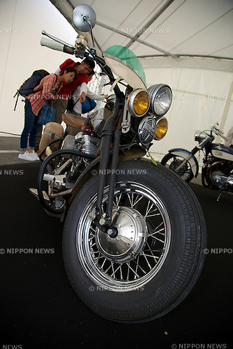 Visitors see a motorcycle Harley Davidson during the Tokyo Motor Fes 2014 on October 11th in Odaiba, Tokyo, Japan. The Tokyo Motor Fes 2014 runs from October 11th to 13th with the aim of giving visitors of all ages a chance to interact with current and futuristic motorized vehicles. Held outside on reclaimed land in Tokyo Bay the event has enough space for visitors to test new vehicles and for a synchronized driving demonstration by the Cirque de Mobi. This year Mercedes-Benz and BMW will also participate along with 13 Japanese makers. (Photo by Rodrigo Reyes Marin/AFLO)
