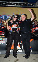 Jul. 1, 2012; Joliet, IL, USA: NHRA  pro stock driver Erica Enders celebrates with her crew and team owner after winning the Route 66 Nationals at Route 66 Raceway. Mandatory Credit: Mark J. Rebilas-
