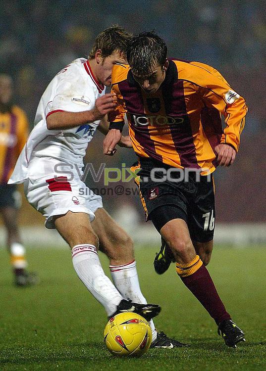 Pix: Oskar Vierod/SWpix.com....Football......Nationwide first division....Bradford v Nott'm Forest...14/12/2002..COPYRIGHT PICTURE>>SIMON WILKINSON>>01943 436649>>..Bradford's Michael Standing and Forest's Gareth Williams