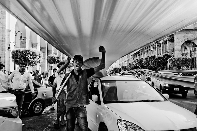 Tripoli, June 17, 2011.On the 4 months anniversary of February 17th uprising, the Libyan regime has organised his largest rally since the crisis began, an estimated 5000 people converged to Green Square as well as hundreds of cars. Not a large number considering the almost 2 million inhabitants of the Libyan capital.